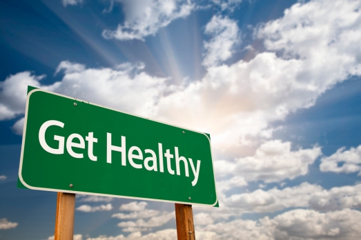 Get Healthy Green Road Sign and Clouds